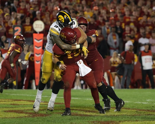 Iowa Hawkeyes defensive end A.J. Epenesa (94) pressures Iowa State Cyclones quarterback Brock Purdy (15) at Jack Trice Stadium earlier this season. Could the Arizona Cardinals pick Epenesa in the 2020 NFL draft?