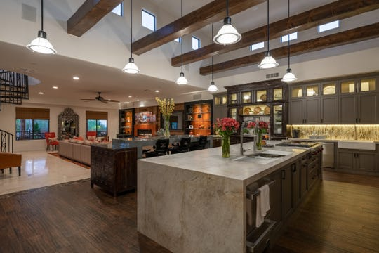 Brent and Adrianna Anderson purchased a $2.65 million Scottsdale mansion that features a kitchen with dual islands.