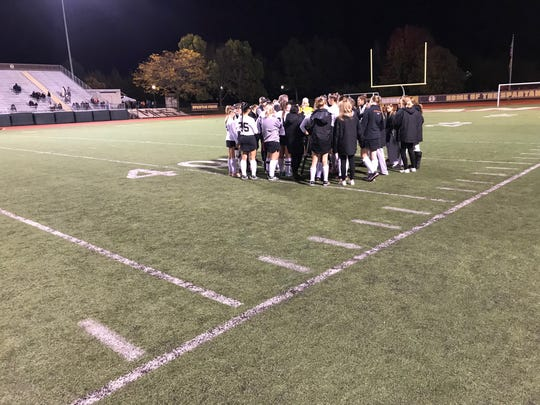 The Palmyra field hockey team discusses strategy at halftime of Wednesday's 7-0 district playoff win vs. Cocalico.