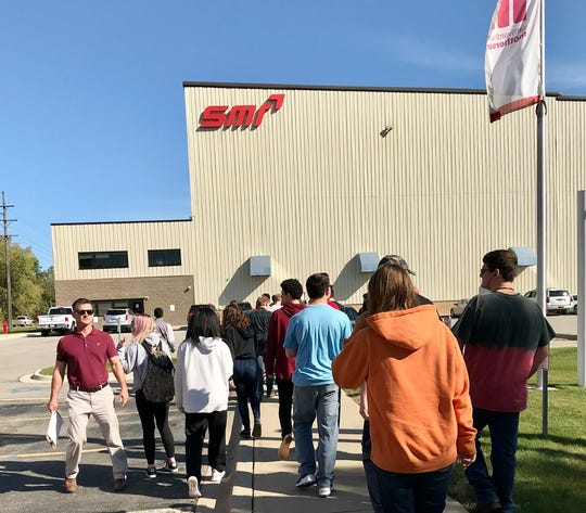 Port Huron High School students take a tour of SMR in Marysville for a Manufacturing Day event on Oct. 10, 2019.