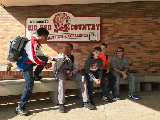 Port Huron High School students wait to take a bus to go to Marysville for a tour of the SMR plant on Oct. 10, 2019.