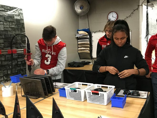 Port Huron High School students Brendon Coronado and Taylor Colston take an aptitude test while taking a tour of SMR's Marysville plant on Oct. 10, 2019.