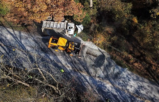 A dump truck crashed and spilled its contents onto Green Valley Road in North Codorus Township Thursday, Oct. 24. John A. Pavoncello photo.