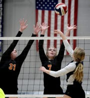 Central York's Sydnie Johnson, left, and Alexa Shorts attempt to block a shot by Dallastown's Ellie Stump during the 2019 York-Adams League girls' volleyball title match in October. Johnson and Shorts also competed for the Ballyhoo club program. Both also plan to play college volleyball at the NCAA level. Bill Kalina photo