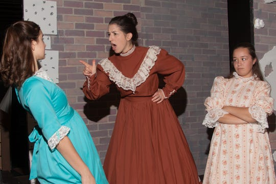 """Alexa Niles, Shelley Stewart and Kirsten Taylor rehearse a scene in """"The Little Princess"""" at DreamWrights Center for Community Arts. The production runs Friday through Nov. 3."""