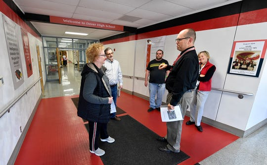 West York Area school board member Douglas Hoover leads a tour through Dover Area High School, where he also works as a history teacher, Oct. 24, 2019.