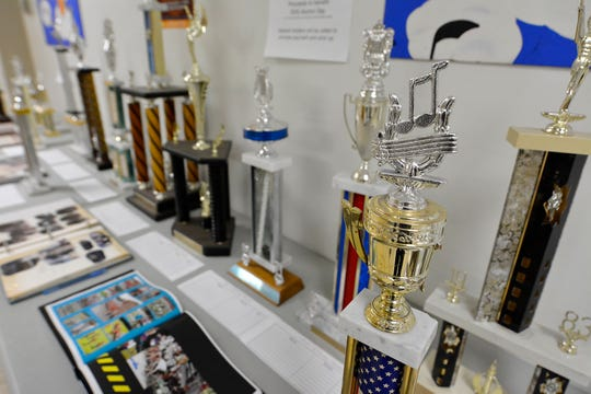 Dozens of music and sports trophies spanning several decades are available through a silent auction at Dover High as the district starts preparations to move into the soon-to-be completed high school. Thursday, October 24, 2019.John A. Pavoncello photo