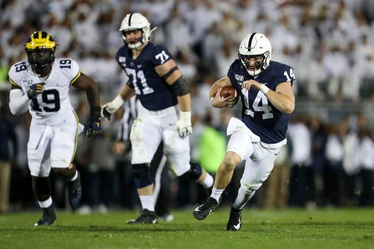 Oct 19, 2019; University Park, PA, USA; Penn State Nittany Lions quarterback Sean Clifford (14) runs the ball during the second quarter against the Michigan Wolverines at Beaver Stadium.  Mandatory Credit: Matthew O'Haren-USA TODAY Sports