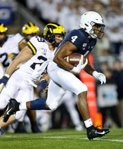 Oct 19, 2019; University Park, PA, USA; Penn State Nittany Lions running back Journey Brown (4) runs with the ball during the first quarter against the Michigan Wolverines at Beaver Stadium. Penn State defeated Michigan 28-21. Mandatory Credit: Matthew O'Haren-USA TODAY Sports