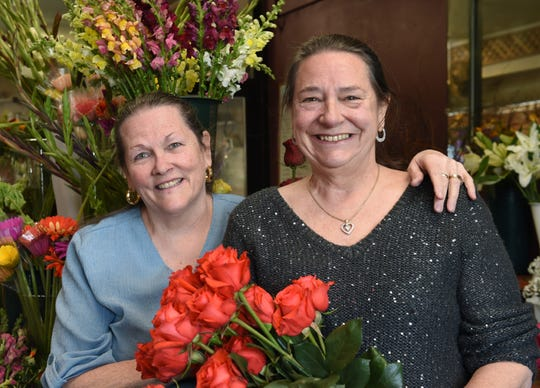Siblings Patty Thornton, left, and Laurie Acton pose for a photo inside the St. Ives Florist. The flower shop will be closing after 27 years of operation.