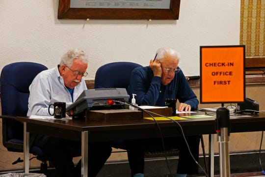 Longtime poll workers Bob Wilson (left) and George Bartindale wait for someone to come along to cast their vote at the Wayne County Courthouse on Thursday, Oct. 24, 2019.
