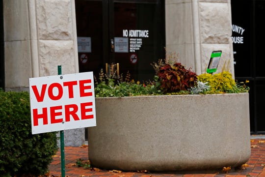 A sign outside the main entrance of the Wayne County Courthouse reminded people once voting had begun for the 2019 municipal election.