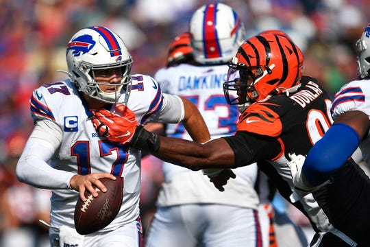 Cincinnati Bengals defensive end Carlos Dunlap (96) reaches for Buffalo Bills quarterback Josh Allen (17) during the second half of an NFL football game on Sept. 22. With the Bengals 0-7, Dunlap, 30, is trade material.