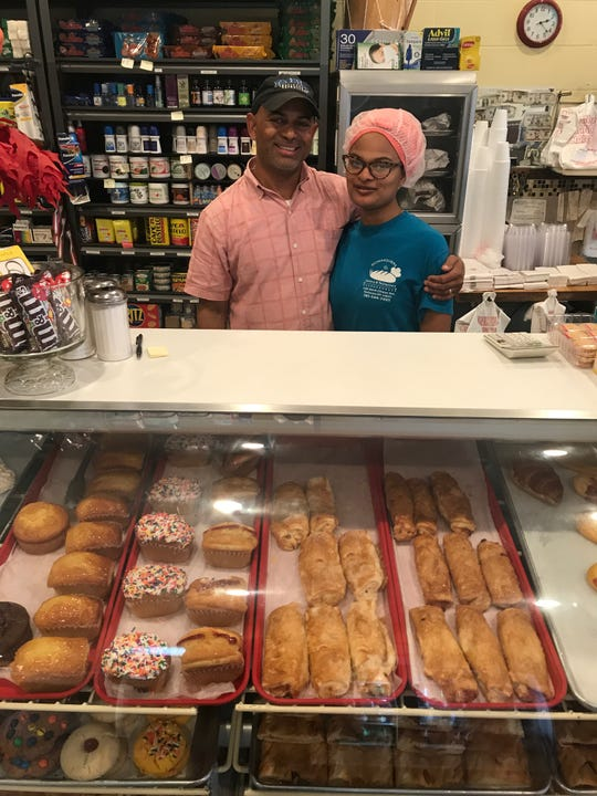 Jose Binet and his daugher, Hillary, are two of the four family members who work together at Borinquen Bakery on North Clinton Avenue.
