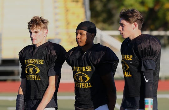 Enterprise High football players Zach McNeil, left to right, Eli Cortinas and Jason Butcher talk Wednesday, Oct. 23, 2019, about the upcoming River Bowl against Shasta on Friday.