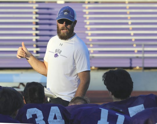 Shasta High School varsity football coach J.C. Hunsaker talks to his team about the upcoming 2019 River Bowl after practice on Wednesday, Oct. 23, 2019.