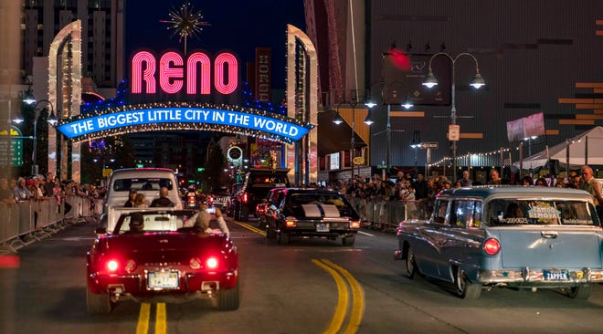 Classic cars cruise under the iconic Reno Arch in downtown as part of Hot August Nights in August. Reno's downtown is still dominated by hotel casinos as the city works to reinvent itself as a high-tech mecca.