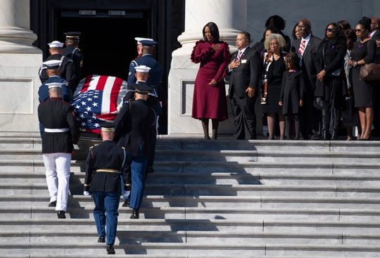 The casket of Rep. Elijah Cummings is carried by honor guard up the Capitol Hill steps where he will lie in state at a ceremony in Statuary Hall in the U.S. Capitol.