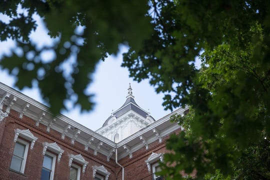 Pioneer Hall is seen through the signature oak trees at Linfield College in McMinnville, Ore., May 21, 2019. Pioneer Hall is the oldest building on the Linfield campus, constructed in 1881.