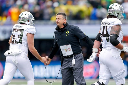 Oct 19, 2019; Seattle, WA, USA; Oregon Ducks head coach Mario Cristobal high-fives players after a touchdown against the Washington Huskies during the second quarter at Husky Stadium. Mandatory Credit: Jennifer Buchanan-USA TODAY Sports