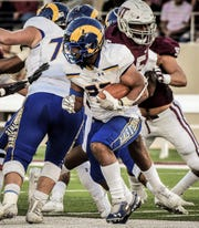 Angelo State University running back Daven Manning runs the ball against West Texas during a Lone Star Conference game in Canyon, Texas on Saturday, Oct. 19, 2019. The San Angelo Central High School graduate made his first appearance against his former college team.