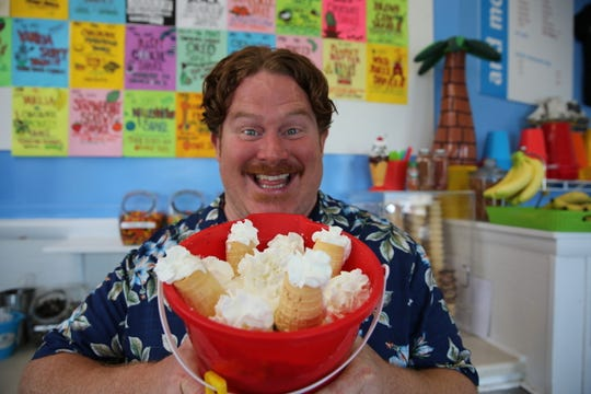 Host Casey Webb poses with the Titanic Sundae Challenge at Justine's Ice Cream Parlour in Ocean City, as seen on Man v. Food, Season 7.