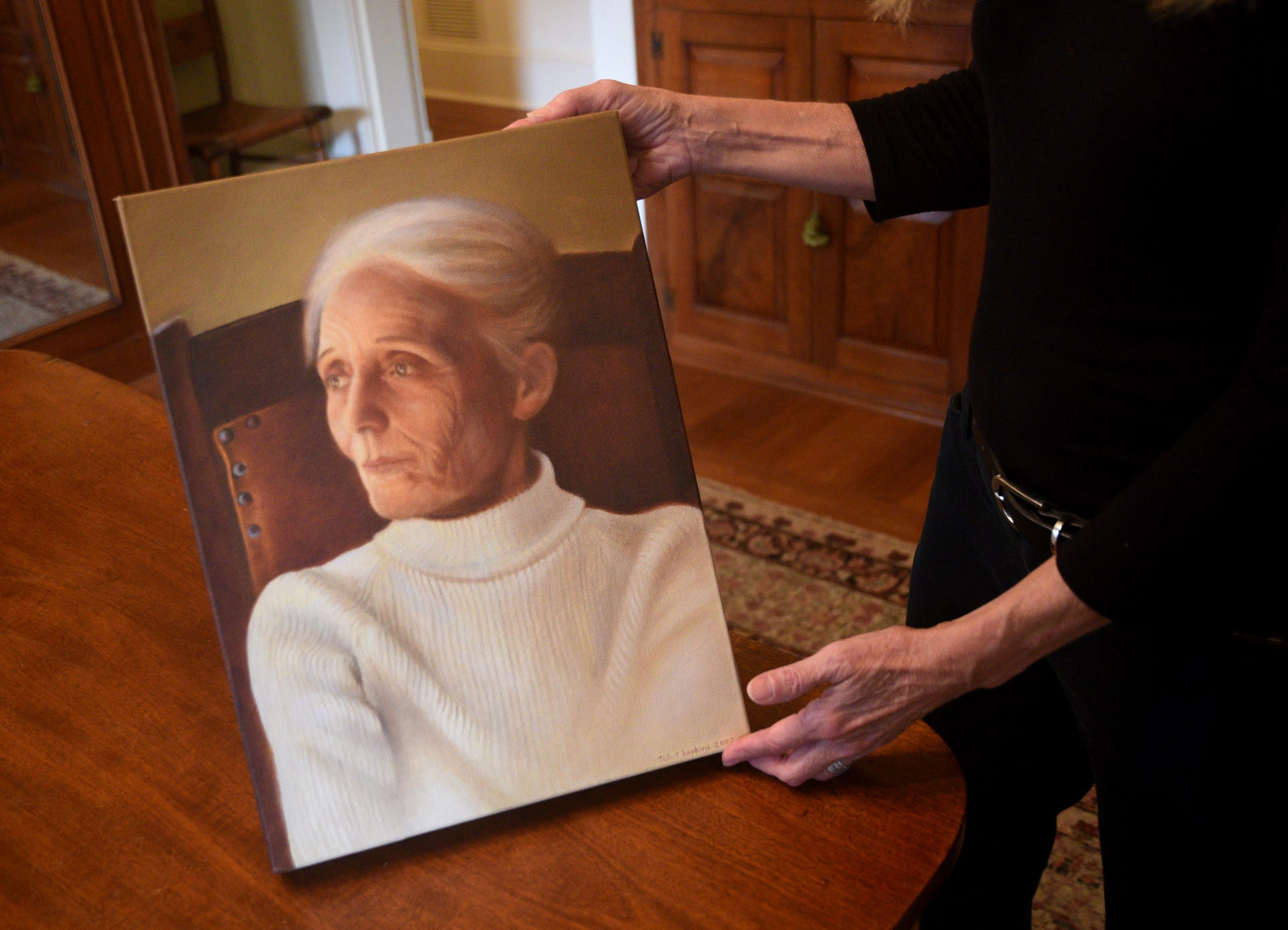 Talbot Hopkins Trudeau holds a painting she did of her great aunt Clyde Connell.