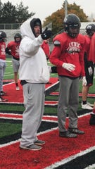 Coach Chad Garrow talks with wide receiver Jackson Hilton at practice on Wednesday, Oct. 23.