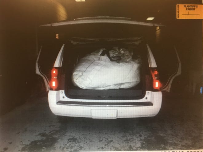 A photo shows white bags containing what driver Robert Herzberg said was hemp when he was arrested in South Dakota.