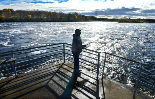 Alvon Carter tries his luck near the St. Cloud Dam on the Mississippi River in October 2019.