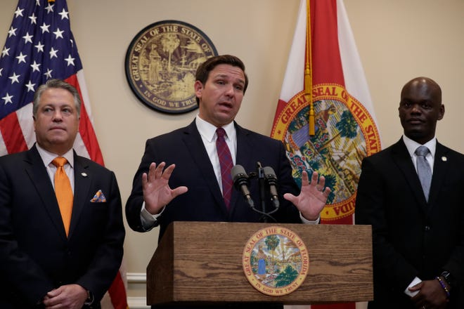 Gov. Ron DeSantis announces that he supports a bill to allow college athletes to profit from their likeness at the Capital Thursday, Oct. 24, 2019.