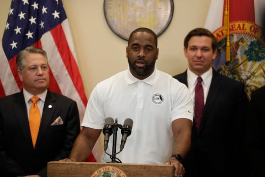 Leon County Commissioner Nick Maddox speaks at a news conference with Gov. Ron DeSantis as the governor announces that he supports a bill to allow college athletes to profit from their likeness at the Capital Thursday, Oct. 24, 2019.