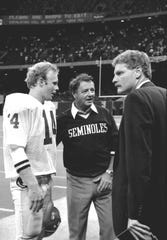 August 31, 1985: Coach Bobby Bowden with quarterback Danny McManus (#14) and Wayne Hogan