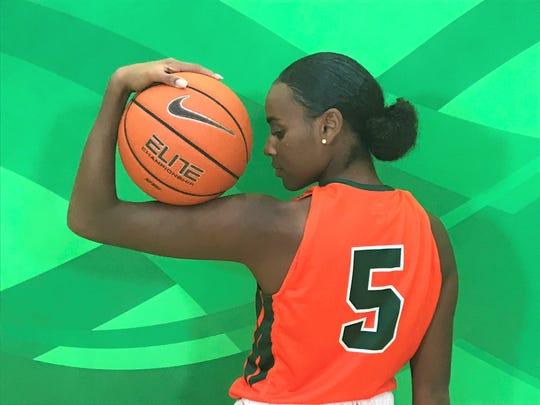 FAMU graduate transfer guard/forward Corey Staples flexes her basketball muscle on Media Day.