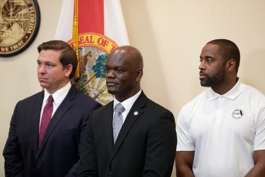 Minority leader Kionne McGhee and Leon County Commissioner Nick Maddox appear with Gov. Ron DeSantis at a news conference where he announced that he supports a bill to allow college athletes to profit from their likeness at the Capital Thursday, Oct. 24, 2019.