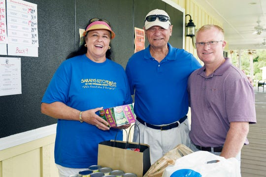 Illona Christie, Sarah's Kitchen Co-Founder Bob Carey and John Bagwell at the 2019 Be a Hunger Hero golf tournament at Legacy Golf & Tennis Club in St. Lucie West.