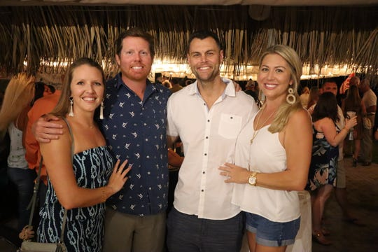 Hayley Butler, left, Daryl Fathauer, and Shannon and Sarah Andersen support the 2019 Michael Shields Memorial Inshore Open benefit for Project L.I.F.T.