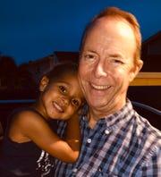 Kevin Sullivan, right, and one of his grandchildren.