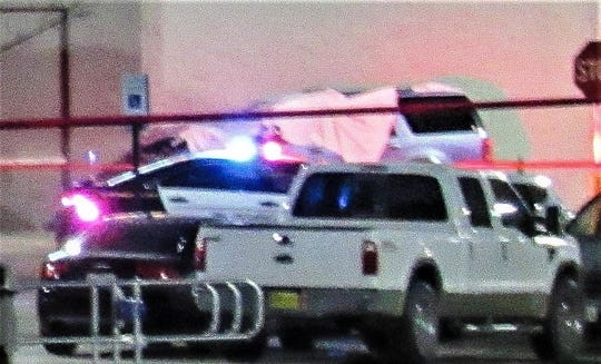 A close-up of a partially covered SUV that crashed into the front of an East Side Walmart. A man was fatally shot on Oct. 23 after trying to flee from El Paso police officers and dragging them with the SUV in the Walmart parking lot at 12236 Montana Ave.
