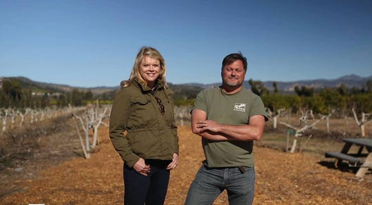 Mary Maranville, founder and CEO of SEEAG, and Chris Sayer of Petty Ranch pose in the Saticoy orchard that serves as SEEAG's Farm Lab. The property, which has been in Sayer's family for more than 100 years, will be open to the public during Ventura County Farm Day on Nov. 9.