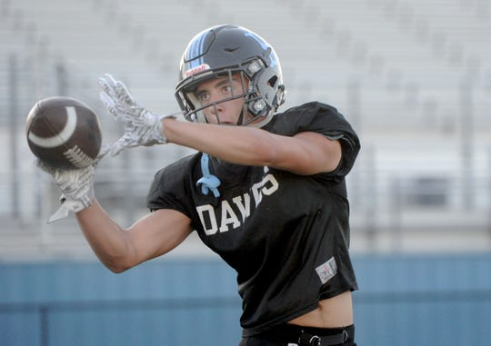 Zac Babcock makes a catch during Buena's football practice Tuesday. The Bulldogs take on rival Ventura on Friday night.