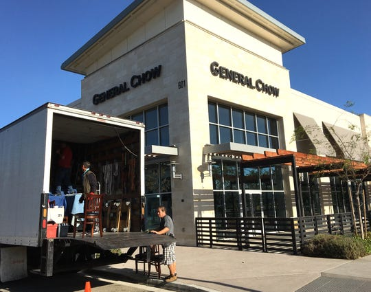 Workers move furniture and kitchen equipment into a van in front of General Chow Dumpling House & Bar at The Collection at RiverPark in Oxnard. The restaurant closed this week.