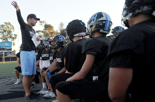 Head coach Ryan Bolland address his Buena High football team practice Tuesday. The Bulldogs are 4-4 overall and 1-2 in the Pacific View League heading into their showdown with rival Ventura High on Friday night.