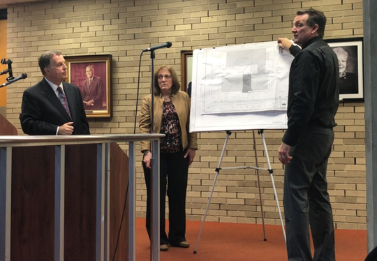 Engineer Ted Wilkinson (right) explains design points for a Rovagnati USA meat plant that will be build in Vineland. City planners approved the plan Wednesday night: Left to right: Rovagnati attorney Louis Magazzu and project planner Lois Kelley.