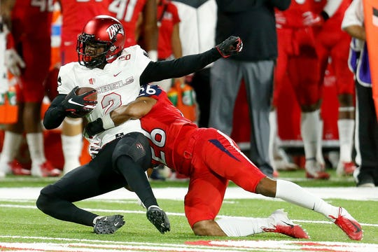 Fresno State freshman defensive back Randy Jordan, right, makes a tackle against UNLV on Oct. 18 at Bulldog Stadium.
