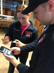 Wausau Fire Lt. Cody Wiesman, right, and firefighter/paramedic Ashley Eggers train with the Handtevy app.