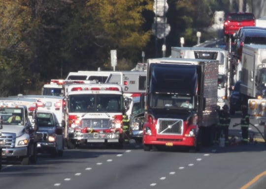 A crash involving a tractor-trailer closed the southbound Thruway in Airmont between Exit 14B/Airmont Road  and the College Road overpass, Thursday, Oct. 24, 2019. A car crashed into the side of the truck can be seen at left of the truck.