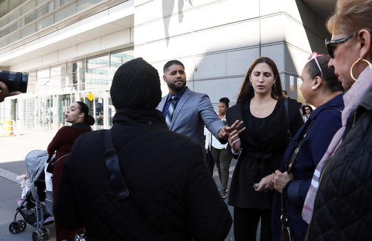 Juan Rodriguez, the New City father whose 1-year-old twins died in his hot car, and his wife Marissa, tell their family to ignore a passerby as they leave Bronx Criminal Court Oct. 24, 2019. Rodriguez's case was adjourned to Dec. 5.