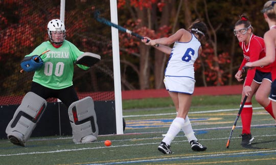 Ketcham goalkeeper Katelyn Albert readies to defend a shot from Mahopac's Krista Dietz (6) during an Oct. 23 field hockey game.