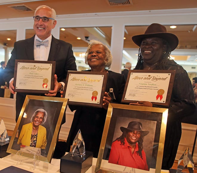 From left, Paul Adler, Barbara Williams and Virginia Norfleet pose for photos during the Rockland County Commission on Human Rights' Civil Rights Hall of Fame luncheon where the three were inducted as new members at the Nyack Seaport Oct. 24, 2019.